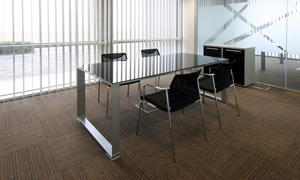 Table and chairs in an office with a wooden floor